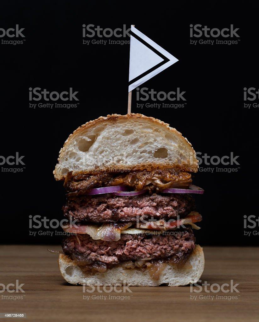 Big double burger half on dark background stock photo