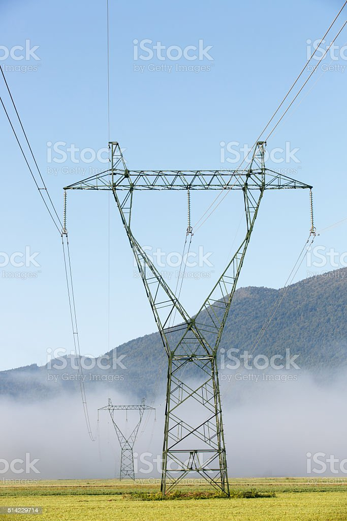Big electricity high voltage pylon with power lines stock photo