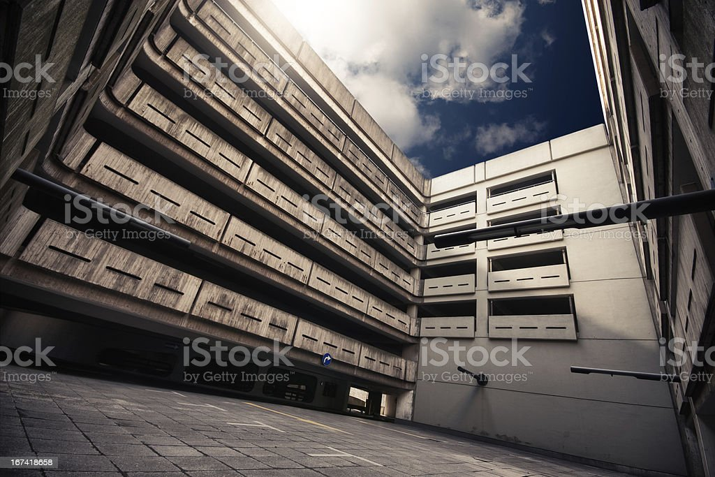 Big exposed concrete courtyard of an empty parking garage stock photo