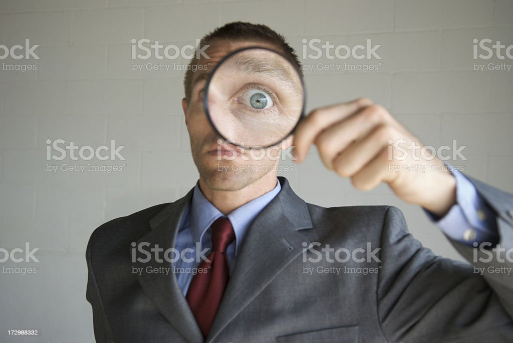 Big Eye Magnifying Glass Businessman Invading Privacy royalty-free stock photo