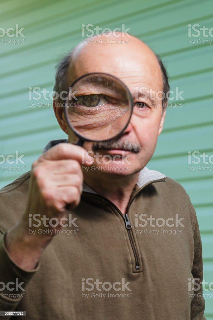 Big eye through a magnifying glass stock photo