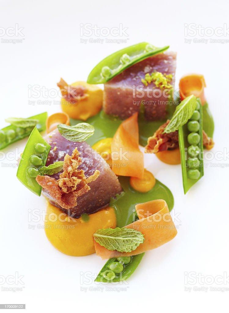 Big eye tuna with pea shoots and crispy prosciutto stock photo