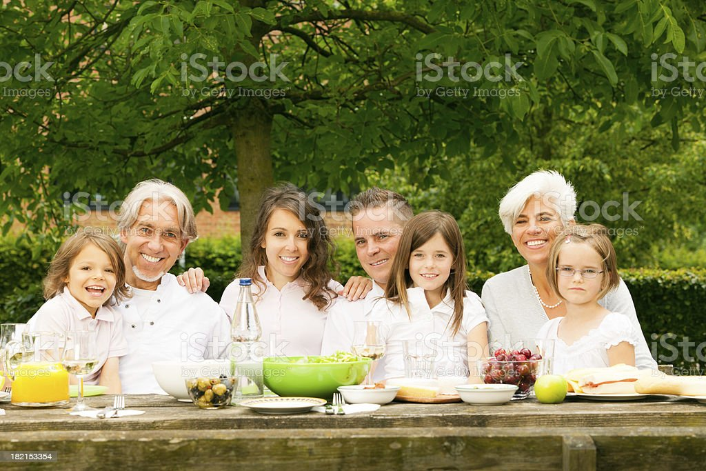 big family having a picnic in the garden royalty-free stock photo