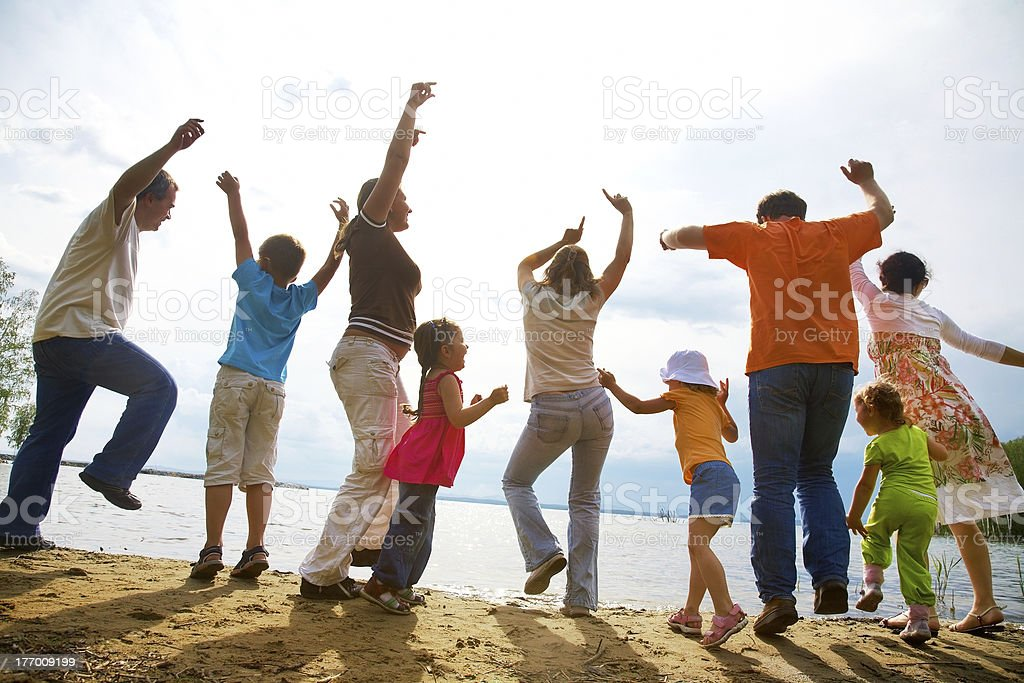 big family party on the beach royalty-free stock photo