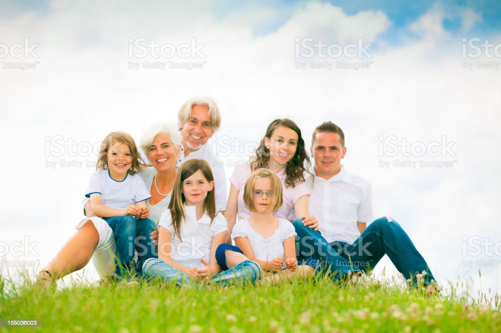 big family standing at the top of a hill royalty-free stock photo