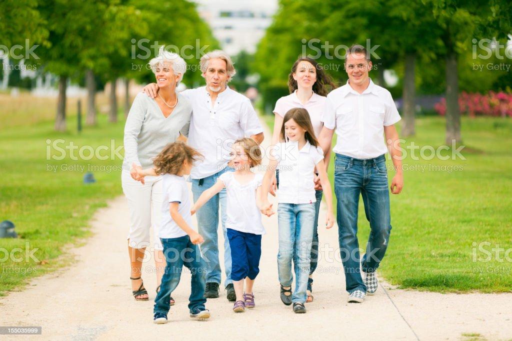 big family walking through the park royalty-free stock photo