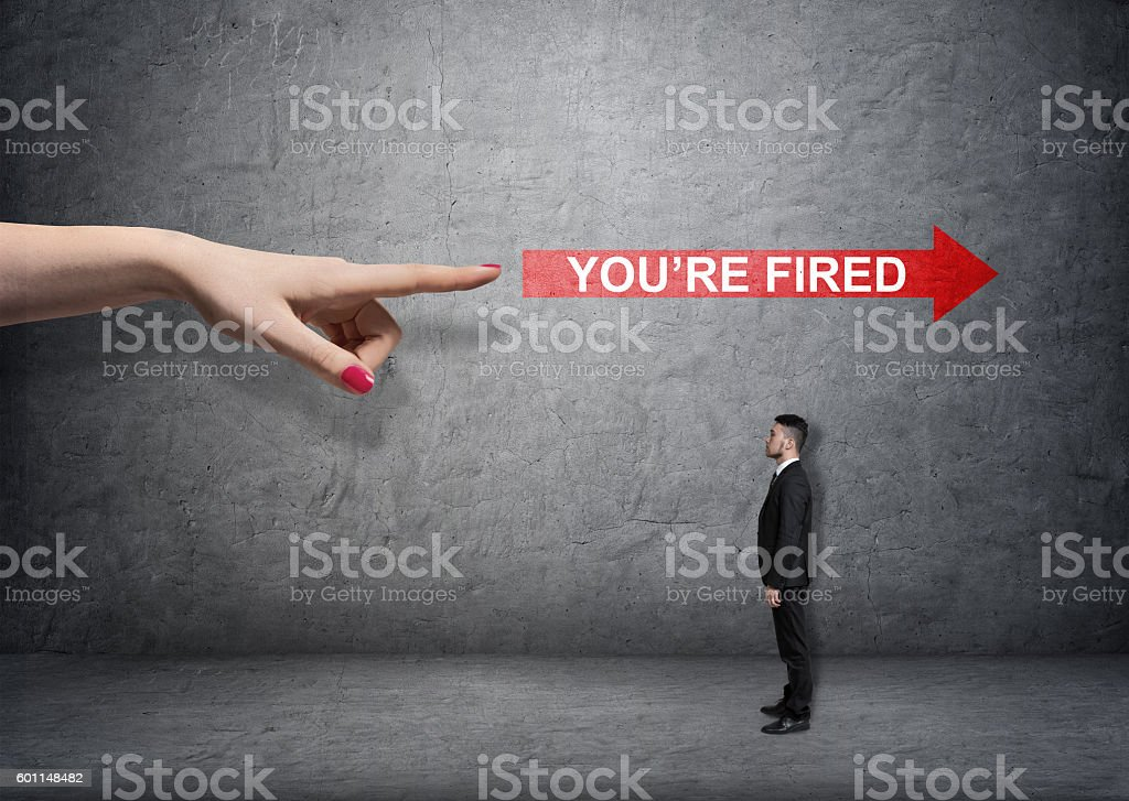 Big female arm pointing at red arrow with 'you're stock photo