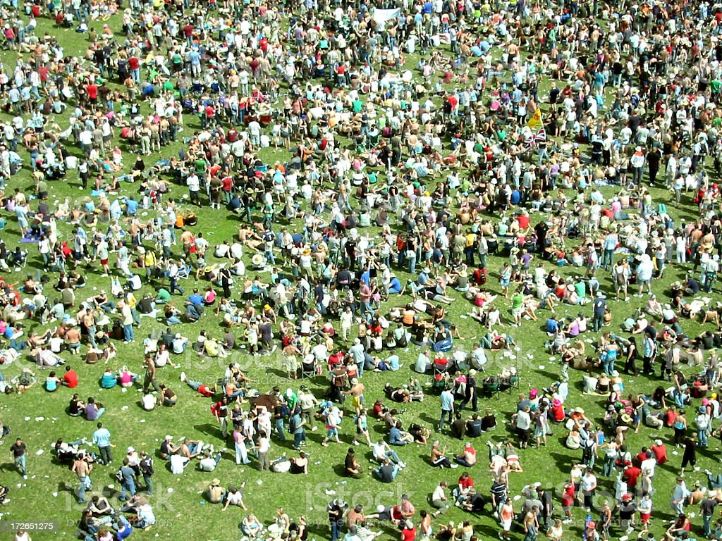 big festival crowd on grass stock photo
