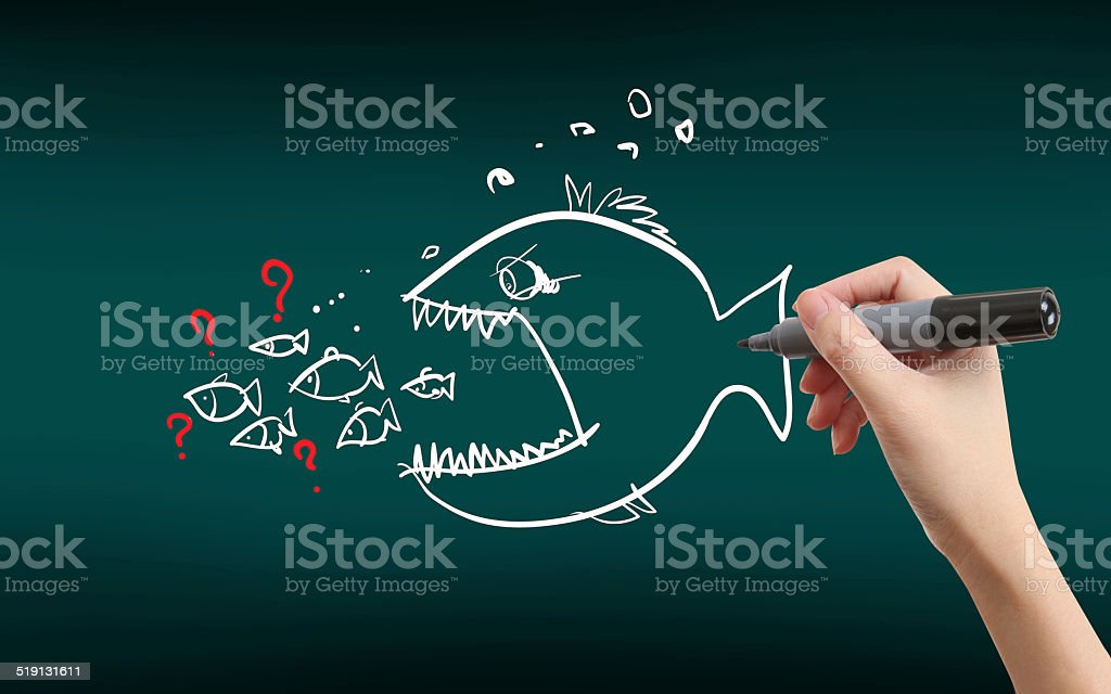 big fish eats small one stock photo