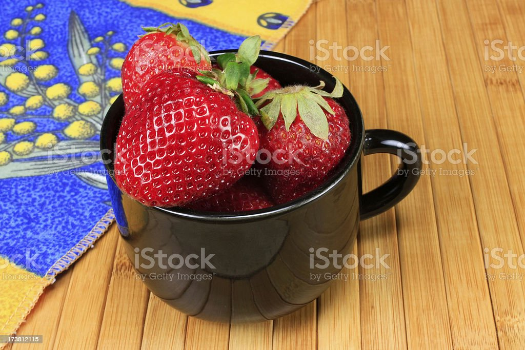 Big Fresh Strawberries in Black Cup royalty-free stock photo