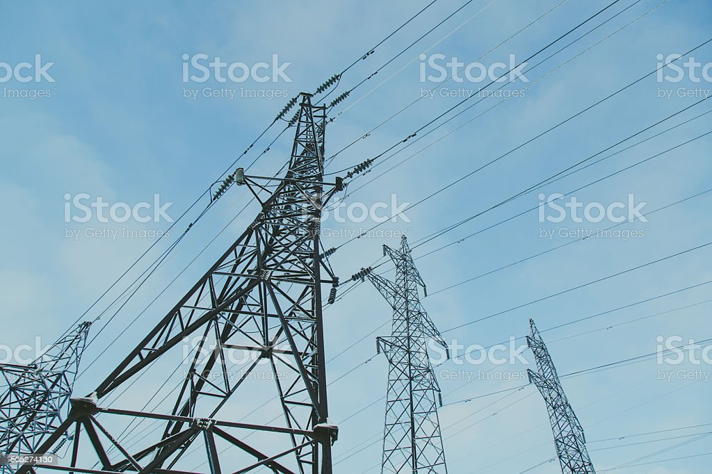 Big frosty power lines among winter. stock photo