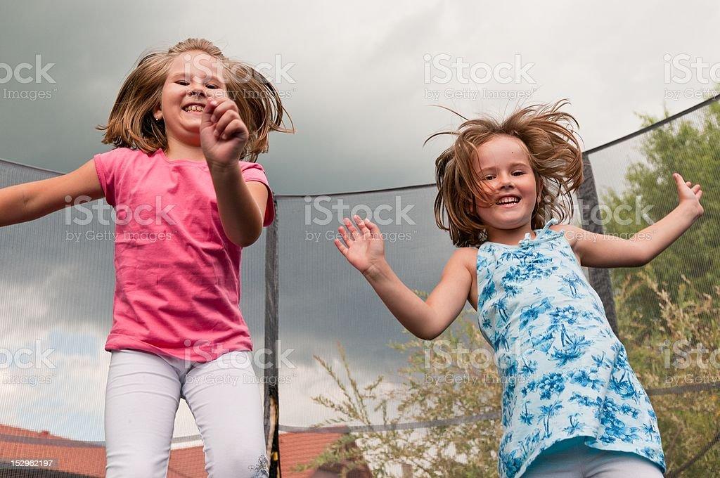 Big fun - childdren jumping trampoline royalty-free stock photo