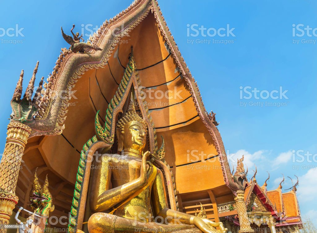big golden buddha statue in Wat Tham Sua buddhist temple stock photo