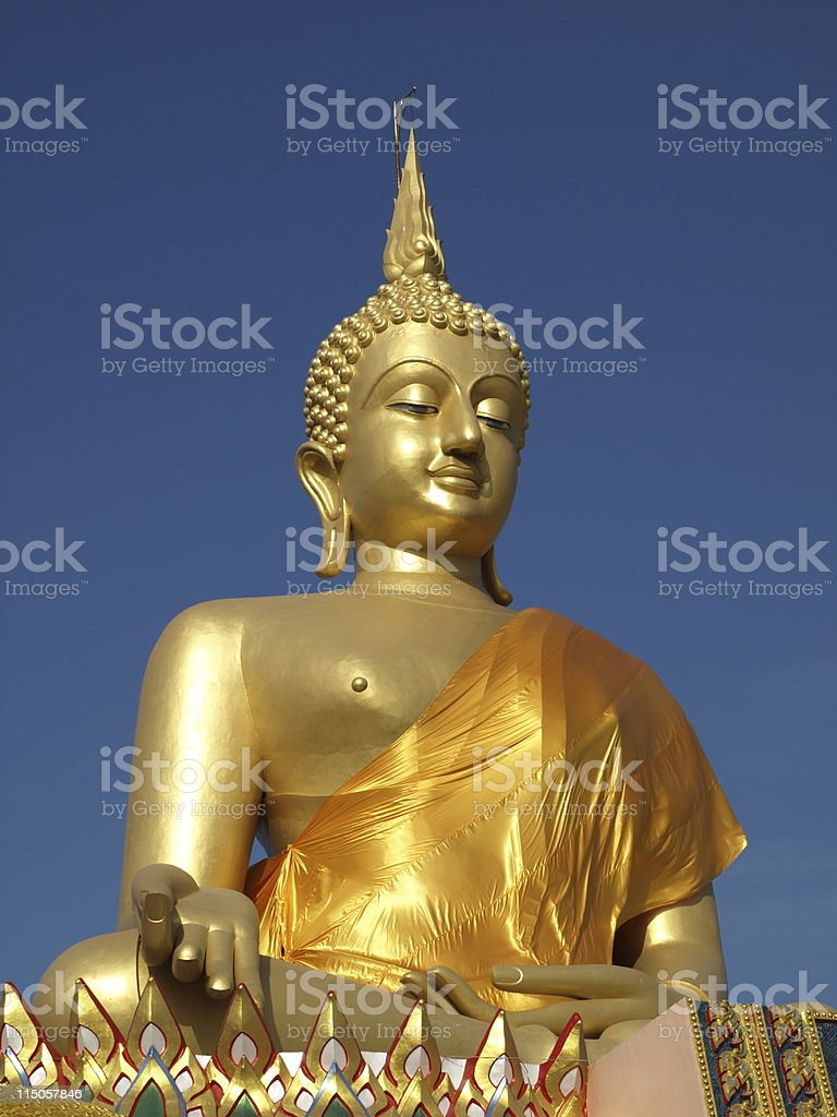 Big golden budha with blue sky stock photo
