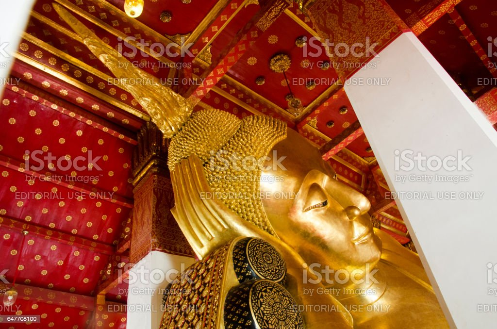 Big golden reclining buddha statue in ubosot or chapel stock photo