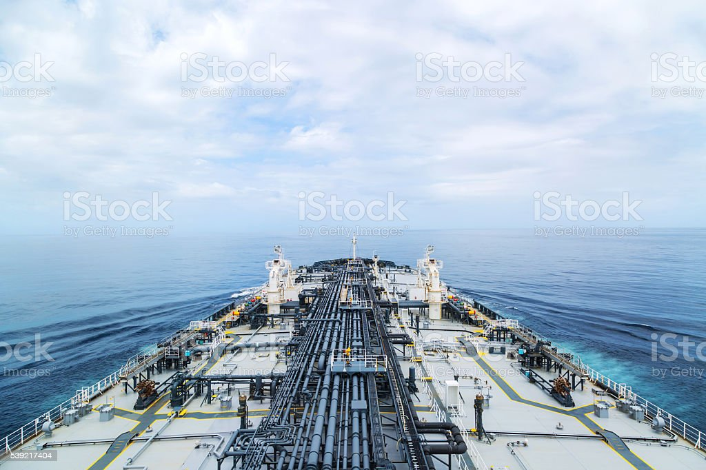 Big grey oil tanker underway in the open sea. stock photo