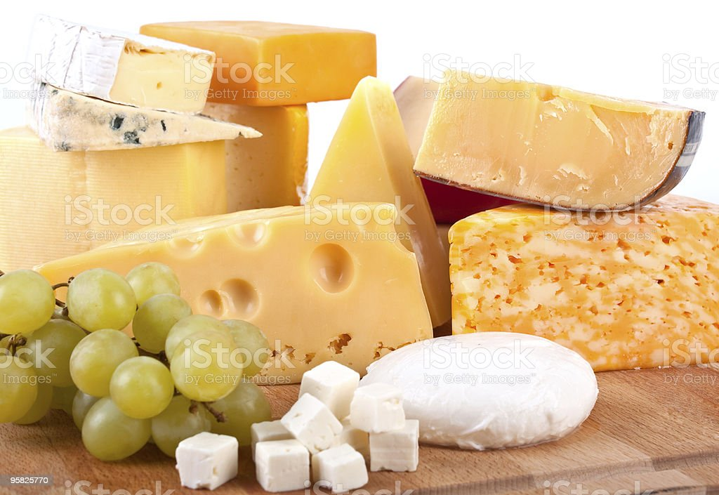 big group of cheeses with white grapes royalty-free stock photo
