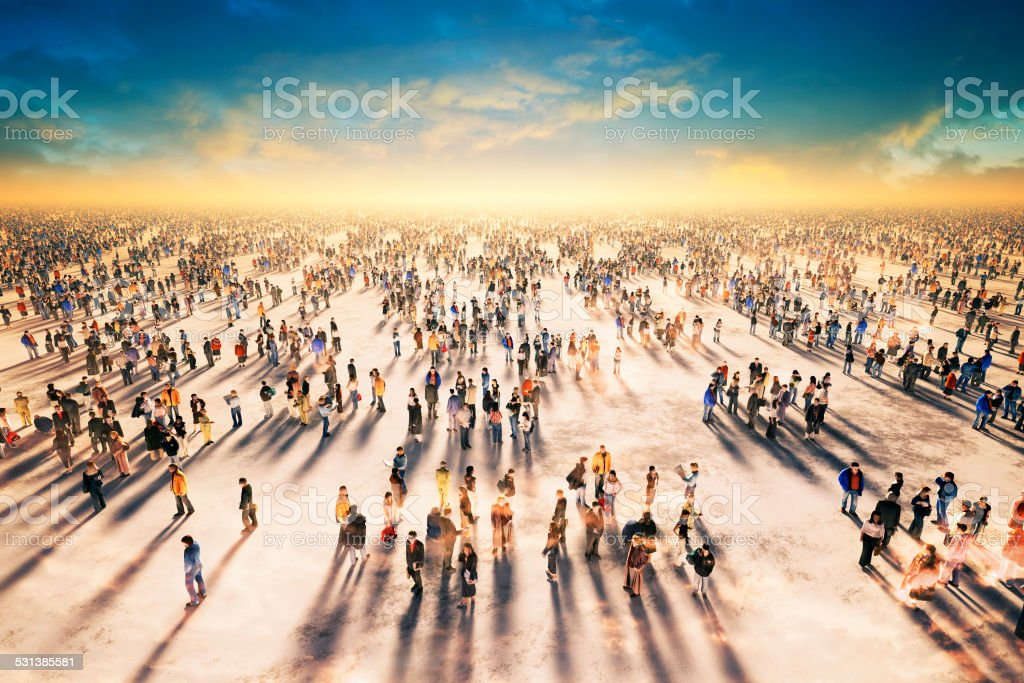Big group of people, crowd, masses, public space, sunset stock photo