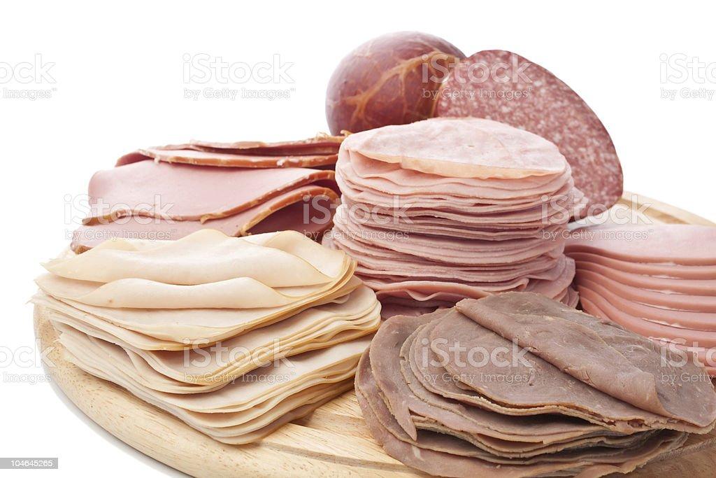 big group of sliced  meat delicatessen stock photo