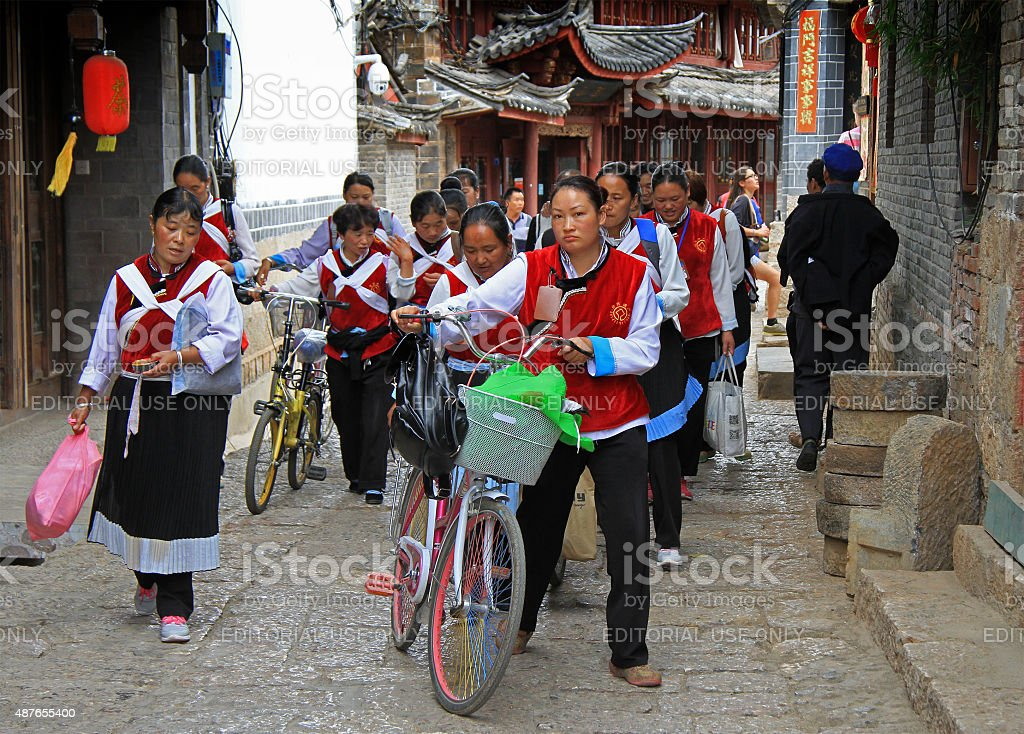 big group of women clothed in the same clothes stock photo