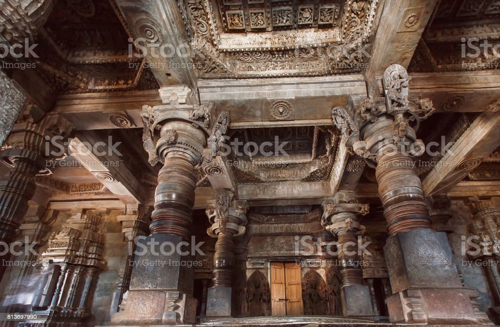 Big hall with stone columns inside the temple in India. Temple built in 12th century stock photo