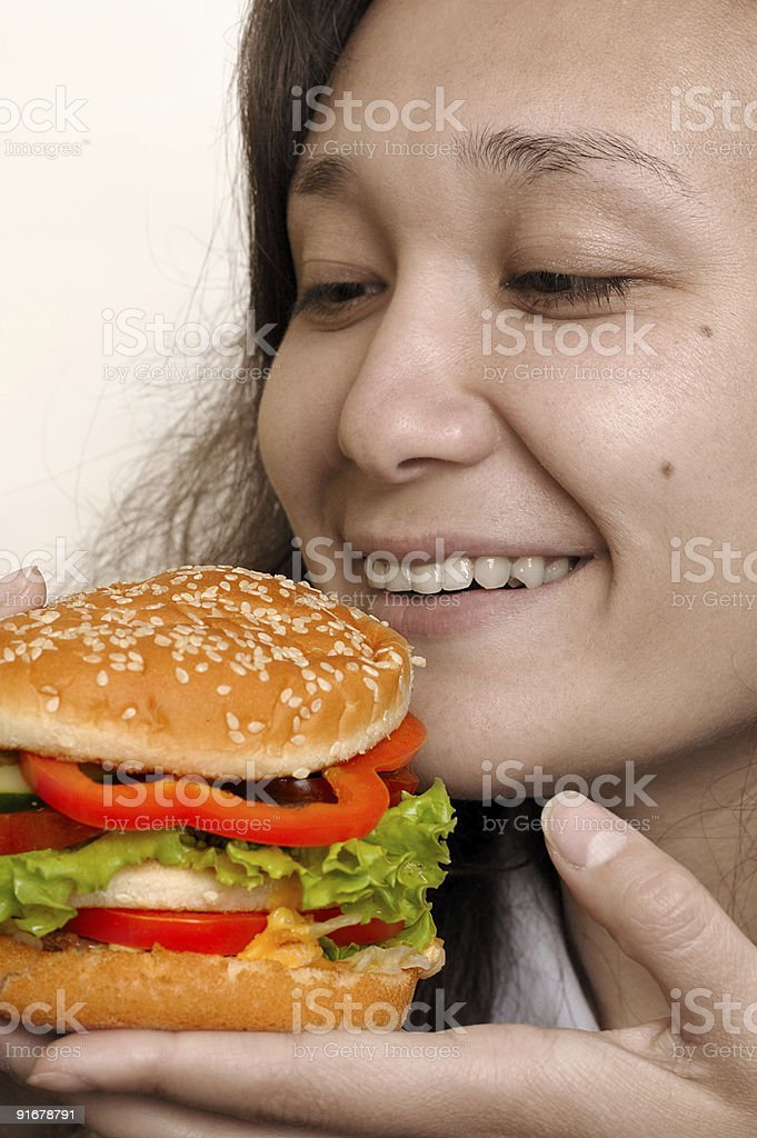 Big hamburger in girl hands meal time royalty-free stock photo