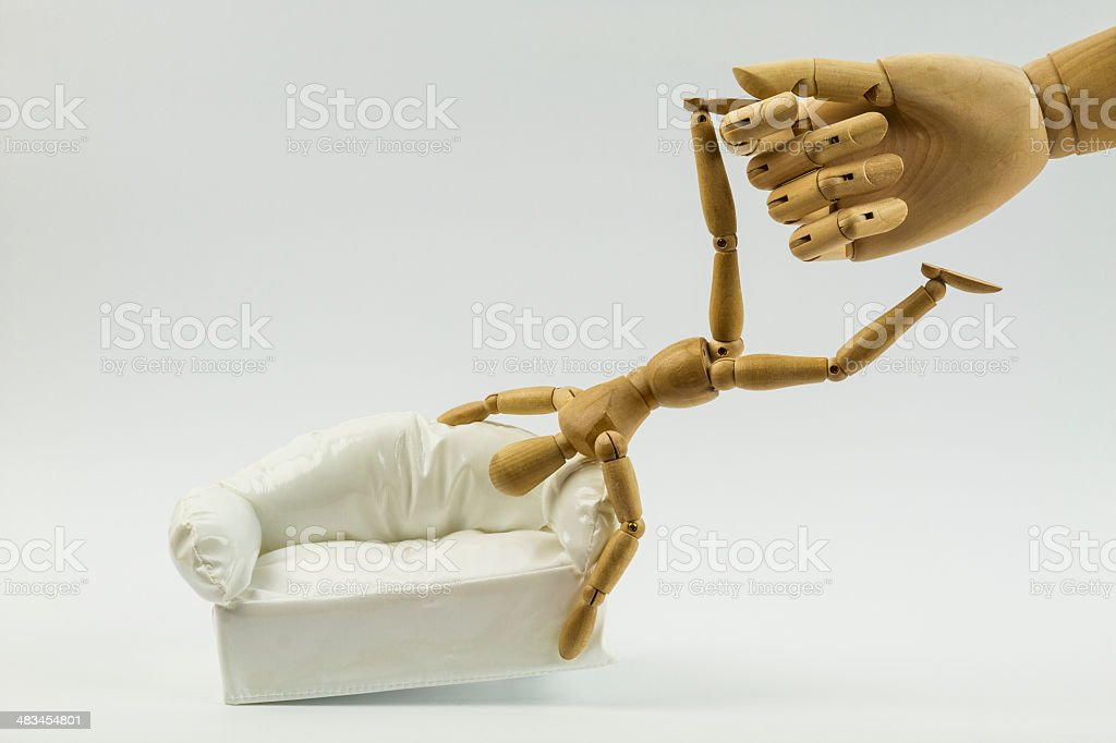 Big hand wakes up a dummy man royalty-free stock photo