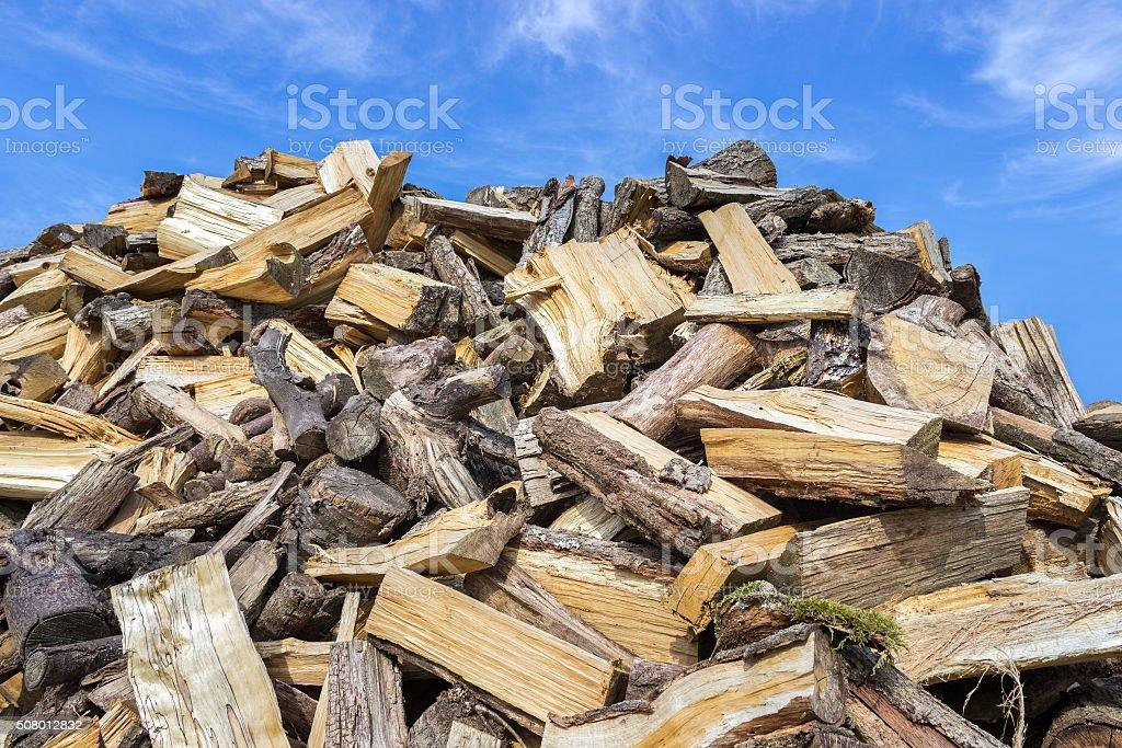 Big heap of chopped tree trunks for burning wood stock photo