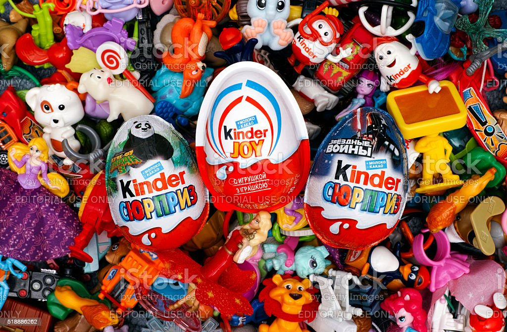 Big heap of Kinder Surprise toys and eggs. stock photo