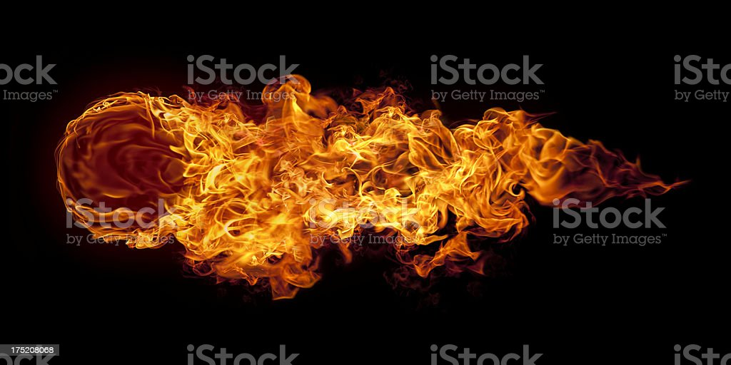 Big horizontal flying fire ball stock photo