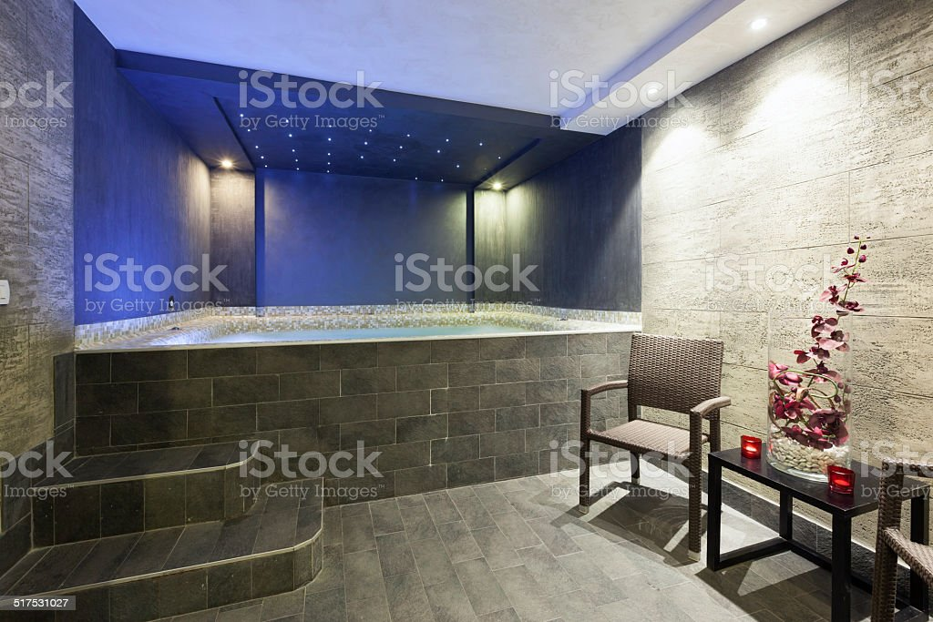 Big jacuzzi with ambient lights stock photo