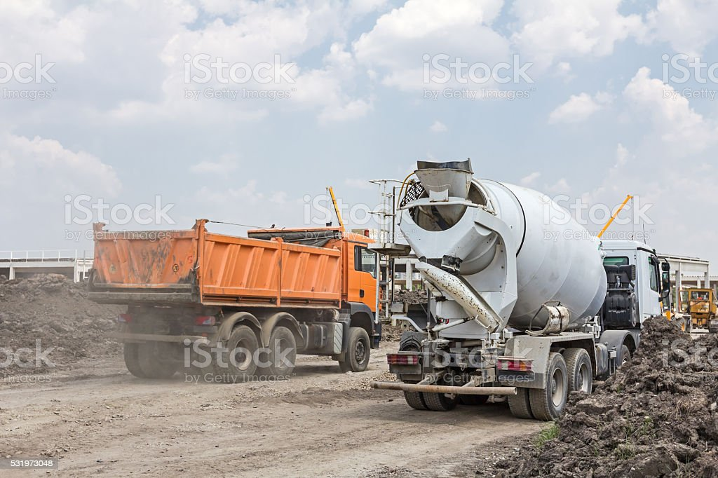 Big hydraulic dump truck is moving on building site stock photo