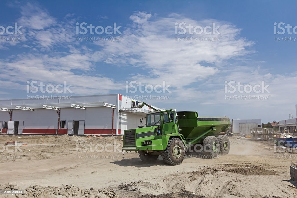 Big hydraulic dump truck is moving. stock photo