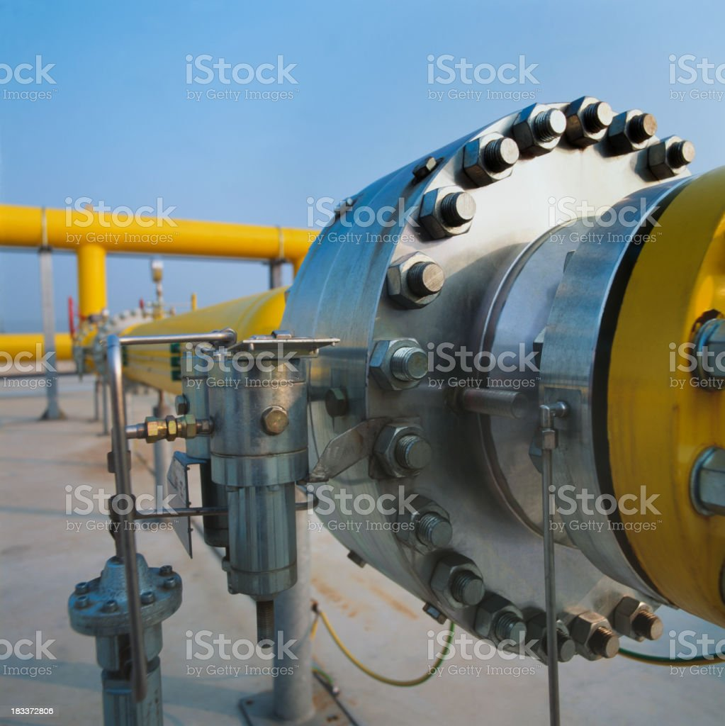 Big joint on yellow pipe in a gas distribution station royalty-free stock photo