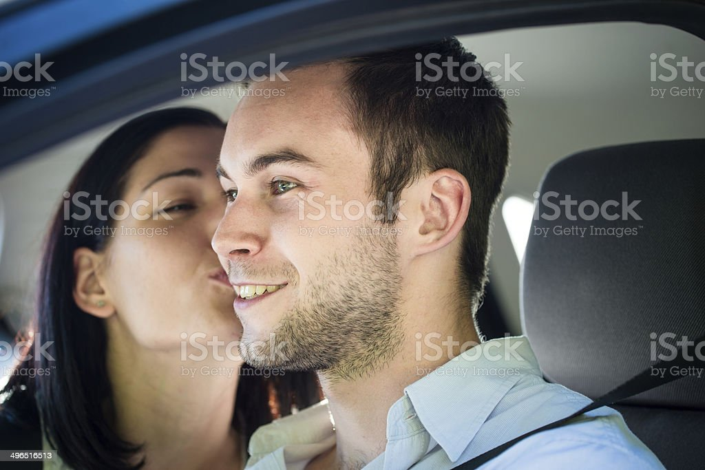 Big kiss in car royalty-free stock photo