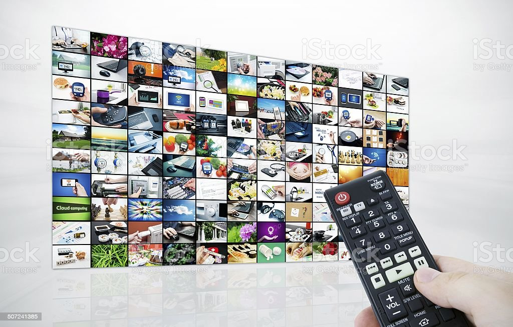Big LCD panel with television stream images and remonte control stock photo