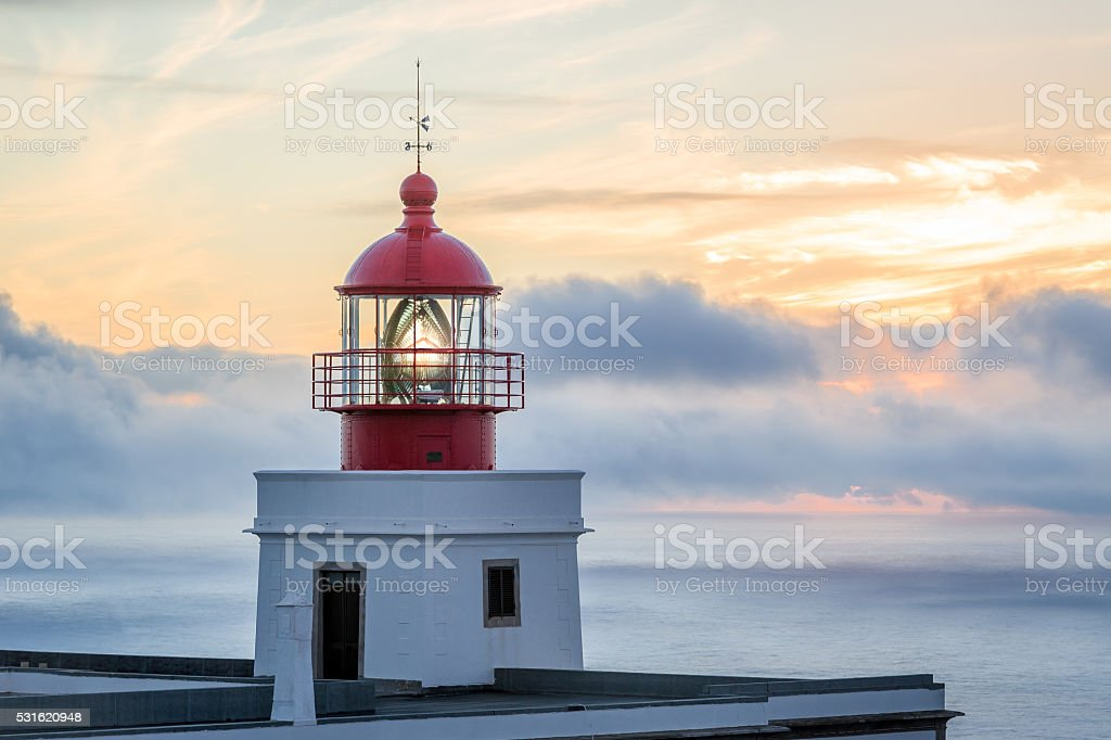 Big lighthouse building and tower at beautiful sunset background stock photo