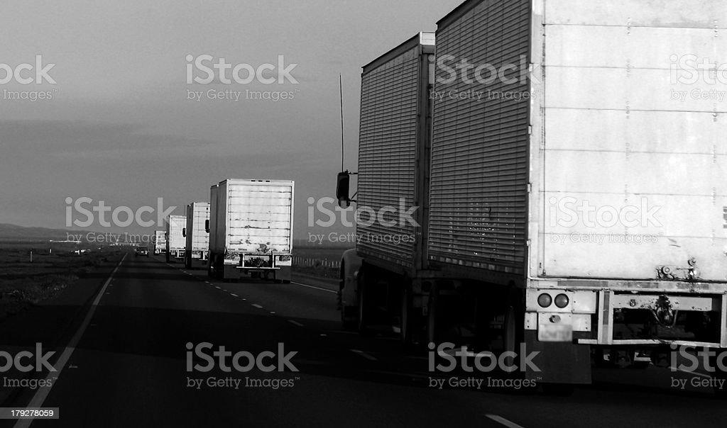Big Line of Semi Trucks on the Freeway royalty-free stock photo