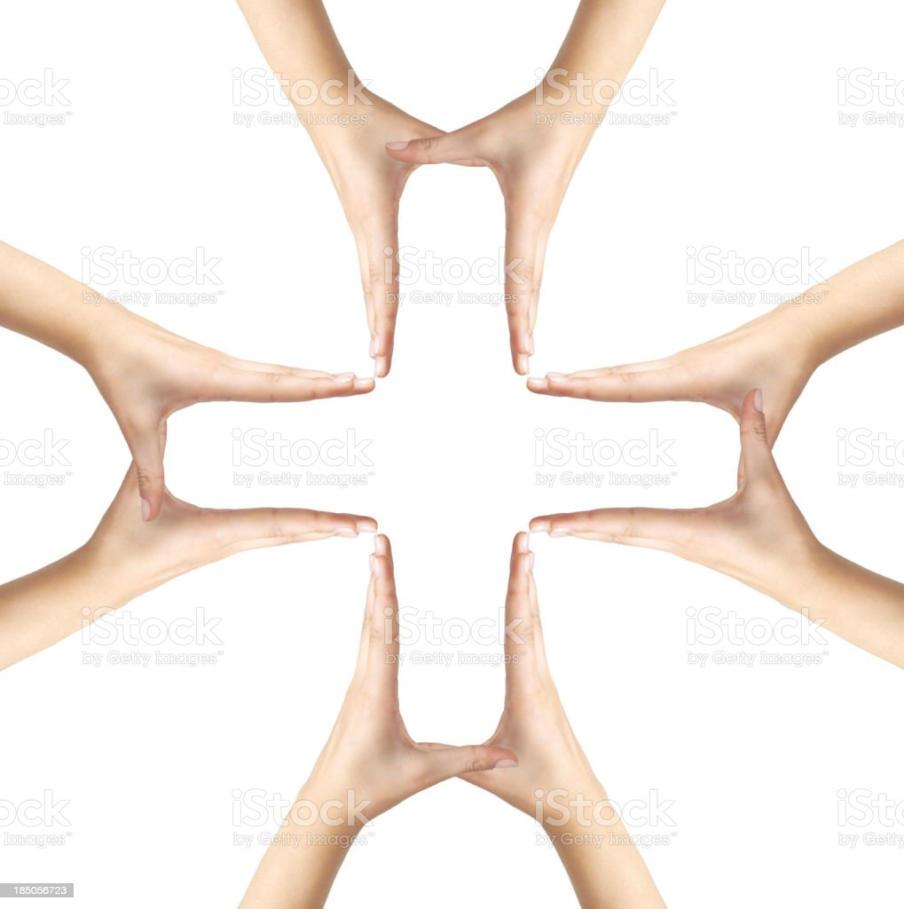 Big Medical Cross symbol from hands isolated stock photo