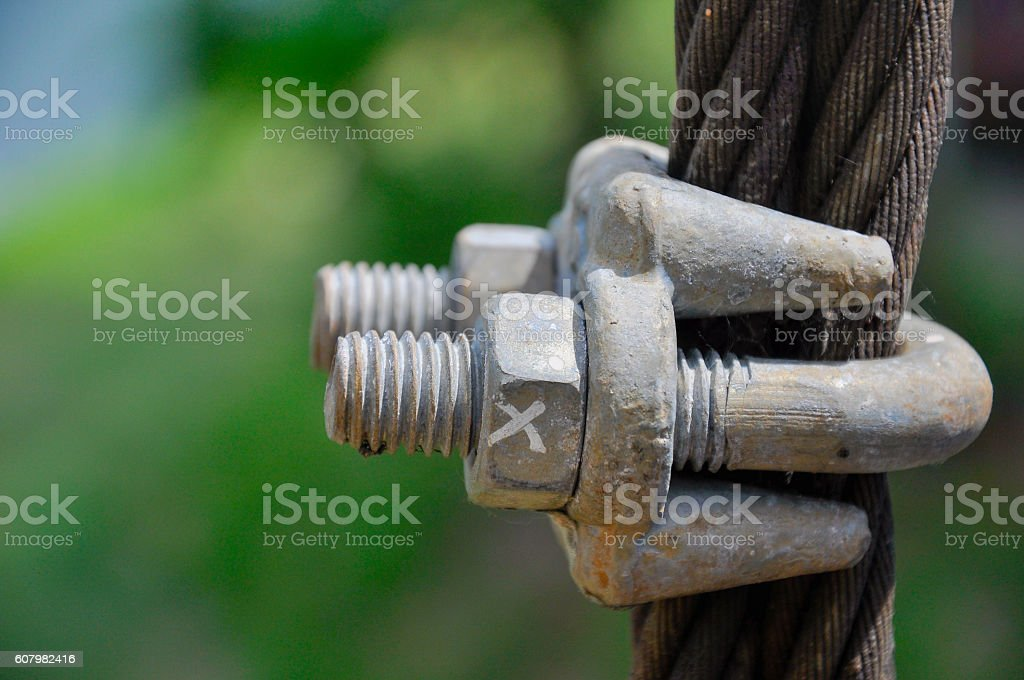 Big metal nut and bolt, marked with an X stock photo