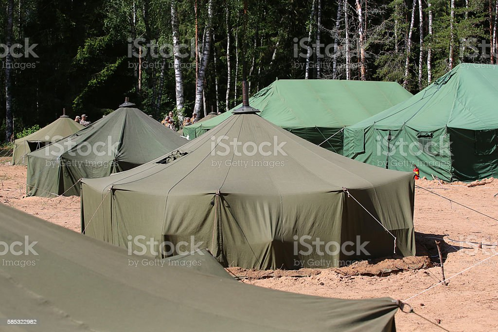 big military tent in the field stock photo