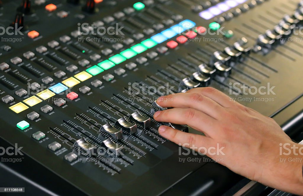 big mixing console with channel to change volume stock photo
