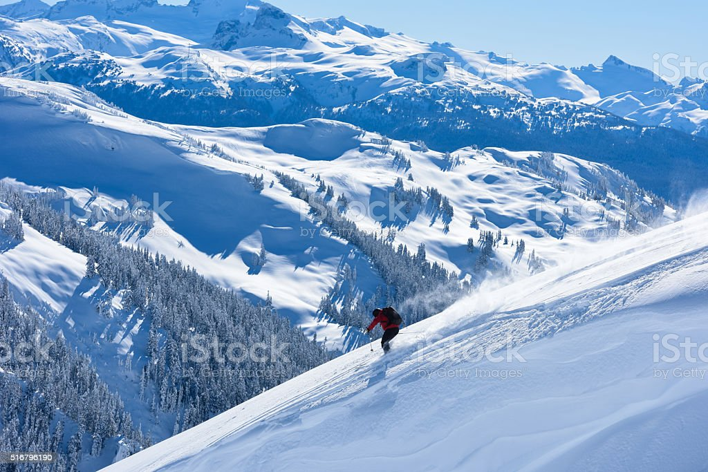 Big mountain powder skiing stock photo