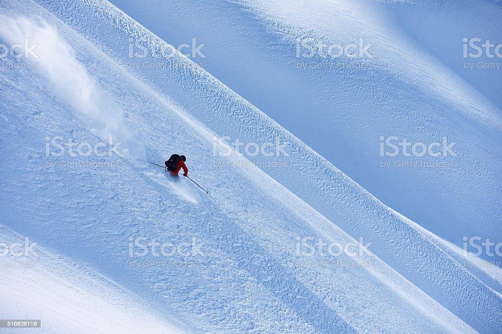 Big mountain powder skiing stock photo
