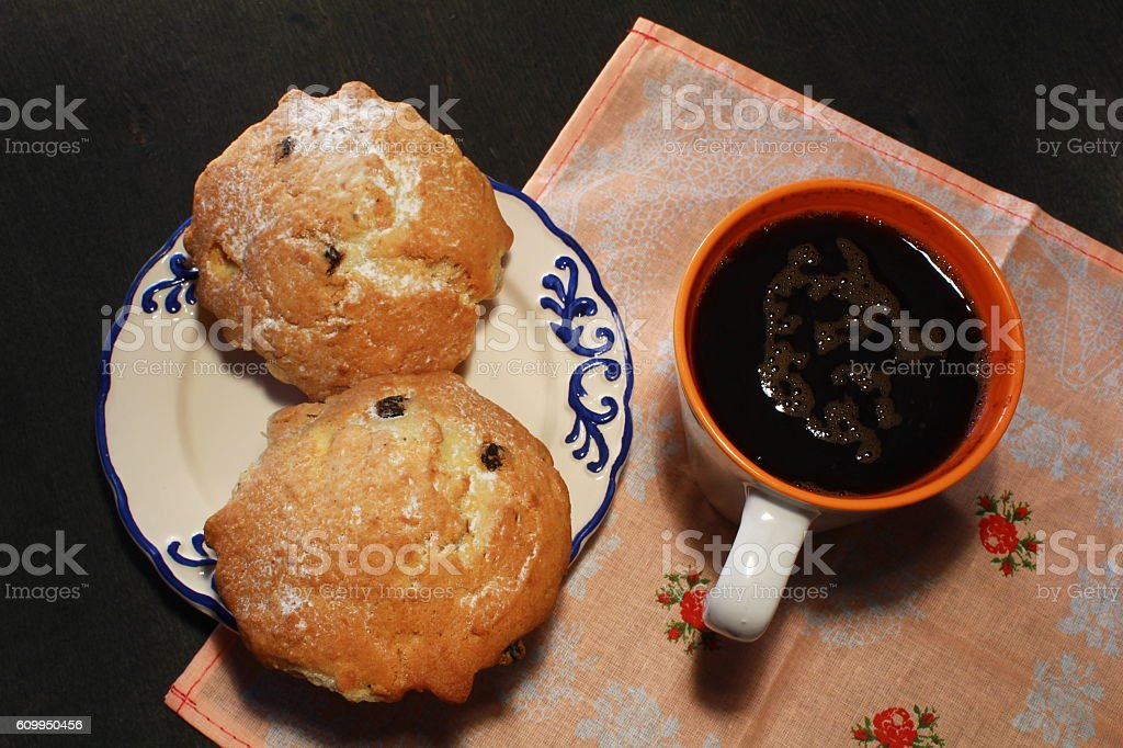 big muffin and coffee on wooden background stock photo
