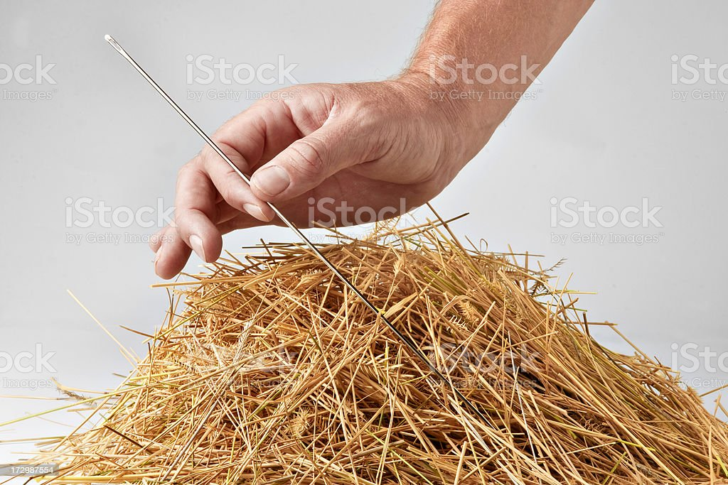 Big needle and a small haystack stock photo