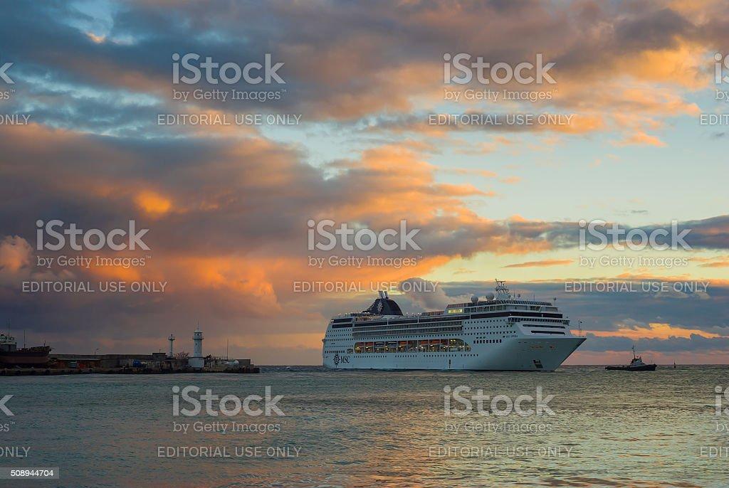 Big oceanic ship calling at Yalta port at fall season stock photo