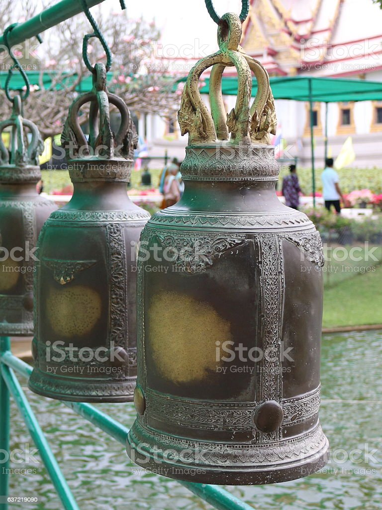 Big old bell hanging beautifully arranged. stock photo