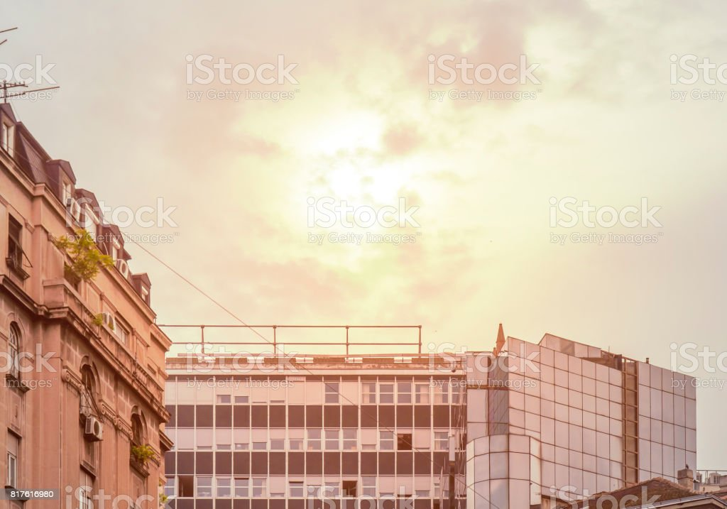 Big orange cloudy sky with old building in city center stock photo