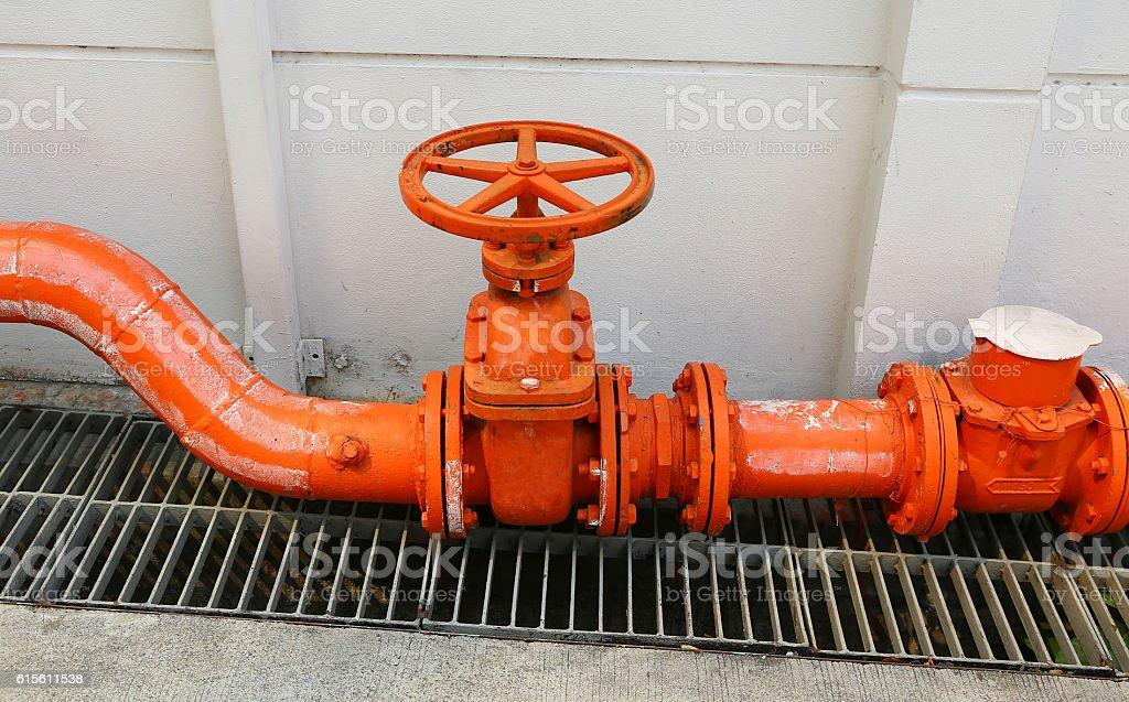 big orange color water supply main pipeline stock photo
